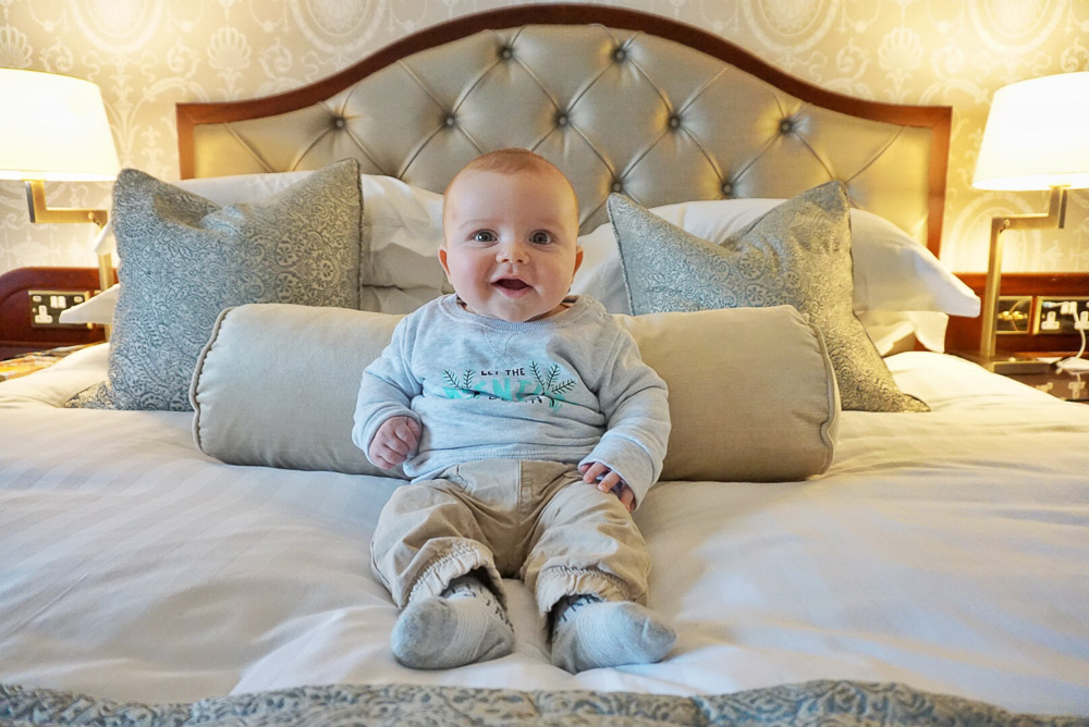 Baby on Hotel Bed